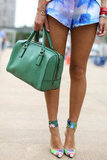 A serene green on this bag gave an understated contrast to high-wattage prints on her shorts and shoes.