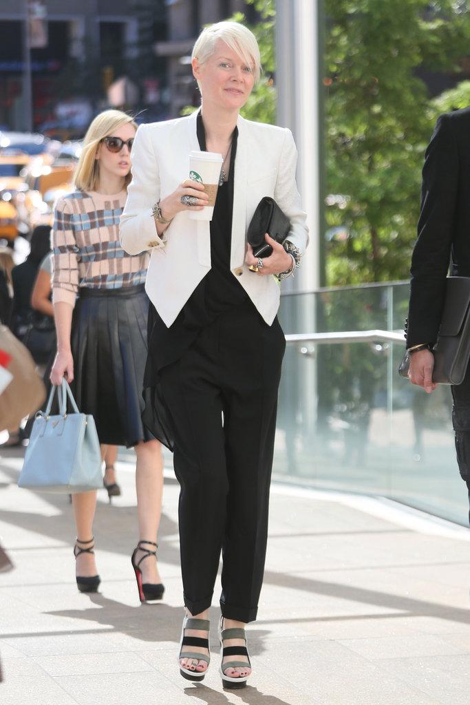 A structured white blazer topped off an all-black look — bonus points for killer heels. Source: Greg Kessler
