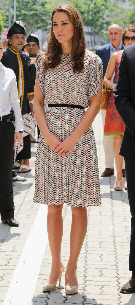 The Duchess teamed a blouse with pleated knee-length skirt and black belt.