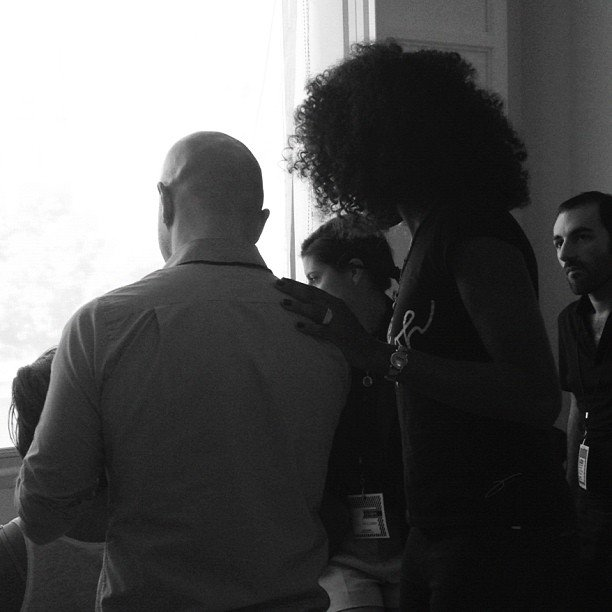 Venus Williams looked on prior to her EleVen showcase as hairstylists prepped models backstage.