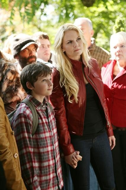 Emma and Henry (Jared Gilmore) hold hands.