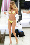 Doutzen Kroes tied on a yellow bikini for a photo shoot in Miami.