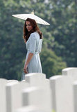 Kate Middleton had a white parasol to shield her from the sun in Singapore.