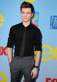 Chris Colfer tucked one hand in his pocket as he posed on the red carpet.