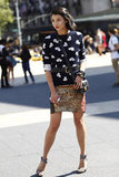 A cheeky sweater met a glittered skirt for a striking Fashion Week combo. Source: Greg Kessler
