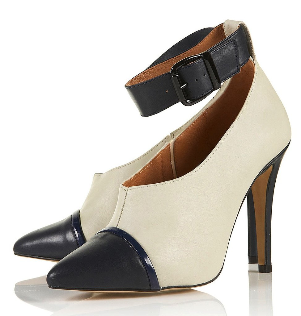This shoe's got it all: a cool cap-toe contrast, a sexy ankle-strap detail, and a slick ivory hue that will complement all of our darker Fall pieces. Topshop Gravity High Vamp Shoe Boots ($140)