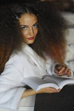 This model paired big hair with a book backstage before the Unique Spring/Summer 2011 show during London Fashion Week in 2010.