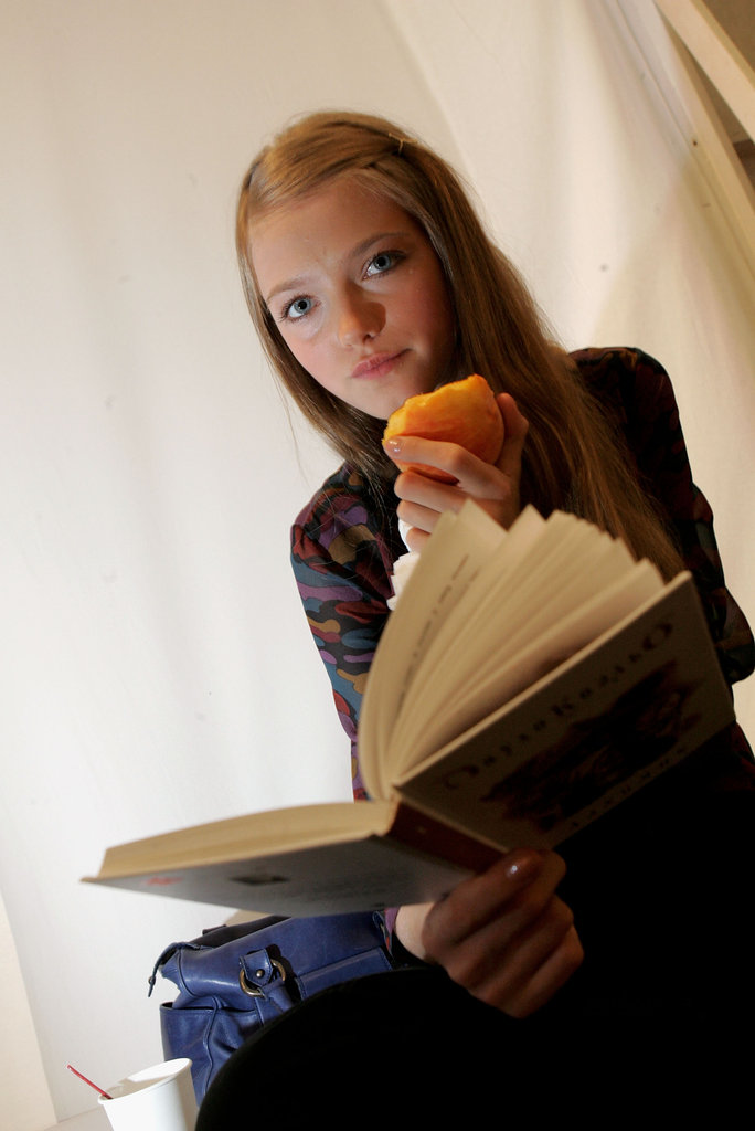 This model for the Chaiken Spring 2006 show in NYC proved that models do eat — and read.