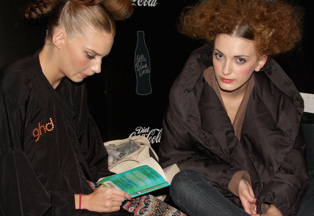 Ben Elton's High Society was the book this model chose to dive into backstage at the 2009 Diet Coca-Cola Little Black Dress Show in Sydney.