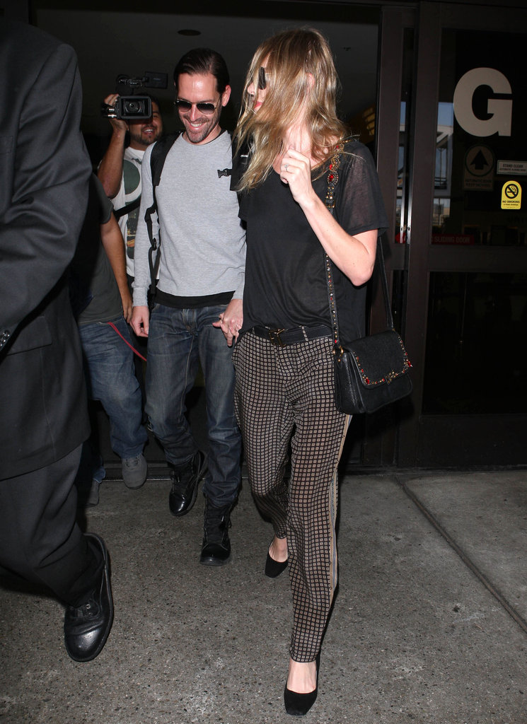 Kate Bosworth wore a pair of striped brown pants as she held hands with Michael Polish.