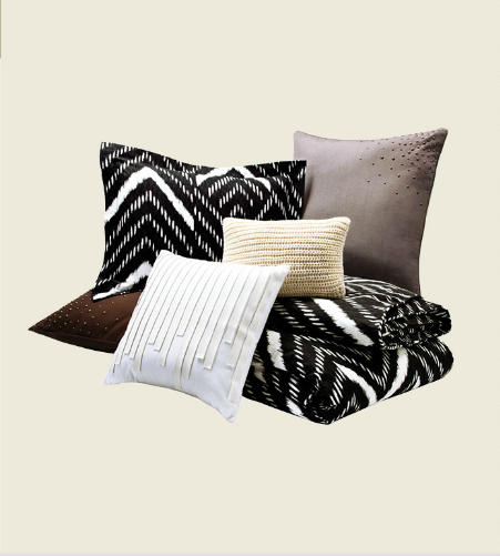 Mini Nepal Chevron Duvet Set ($90), Saville Row Pillow in White ($25), Chunky Knit Throw Pillow in Cream with Gold Detailing ($25), Scattered Stud Pillow in Charcoal and Chocolate ($35)