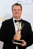 Modern Family's Eric Stonestreet held up his Emmy for outstanding supporting actor in a comedy.