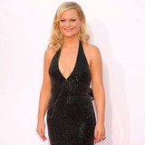 Amy Poehler, mom to Archie, 3, and Abel, 2, showed off her curves in a plunging black dress on the red carpet.