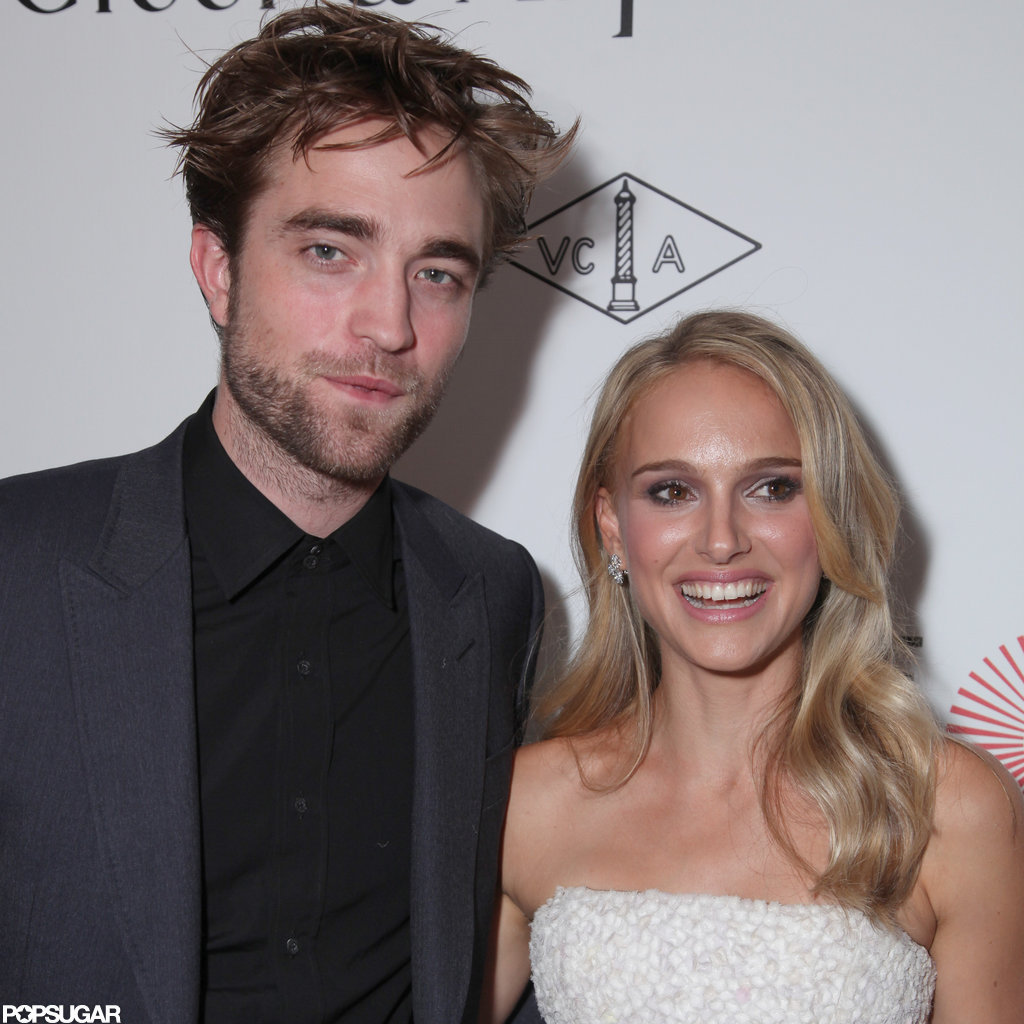 Natalie Portman wore a white dress while Robert Pattinson opted for a dark suit.