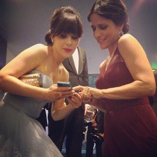 Zooey Deschanel and Julia Louis-Dreyfus looked at photos together backstage. Source: Instagram user jessetyler