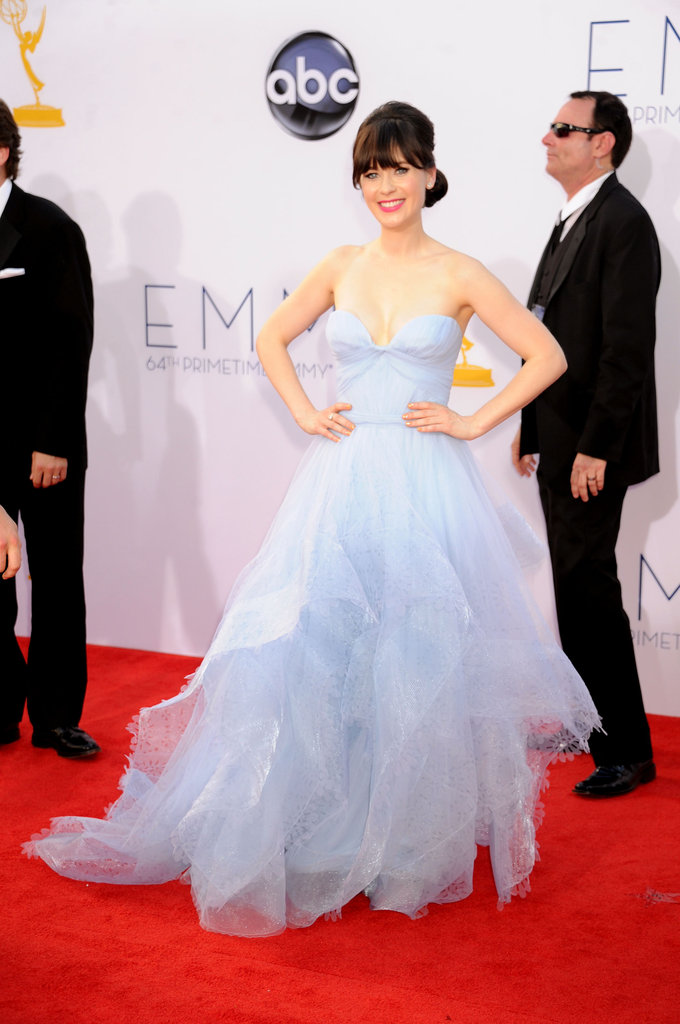 Zooey Deschanel's Reem Acra gown had a princess-style silhouette with a bustier-style top that balanced the volume of her full skirt.