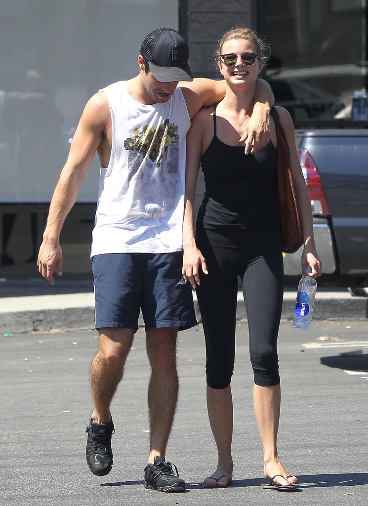 Josh Bowman had his arm around Emily VanCamp as they left the gym.