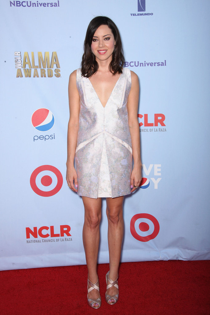Aubrey Plaza slipped into a modern little shift and coordinating satin heels.