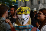 This woman wore an Occupy mask on the back of her head.