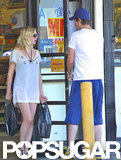 Kirsten Dunst walked out of a market while boyfriend Garrett Hedlund held the door for her.