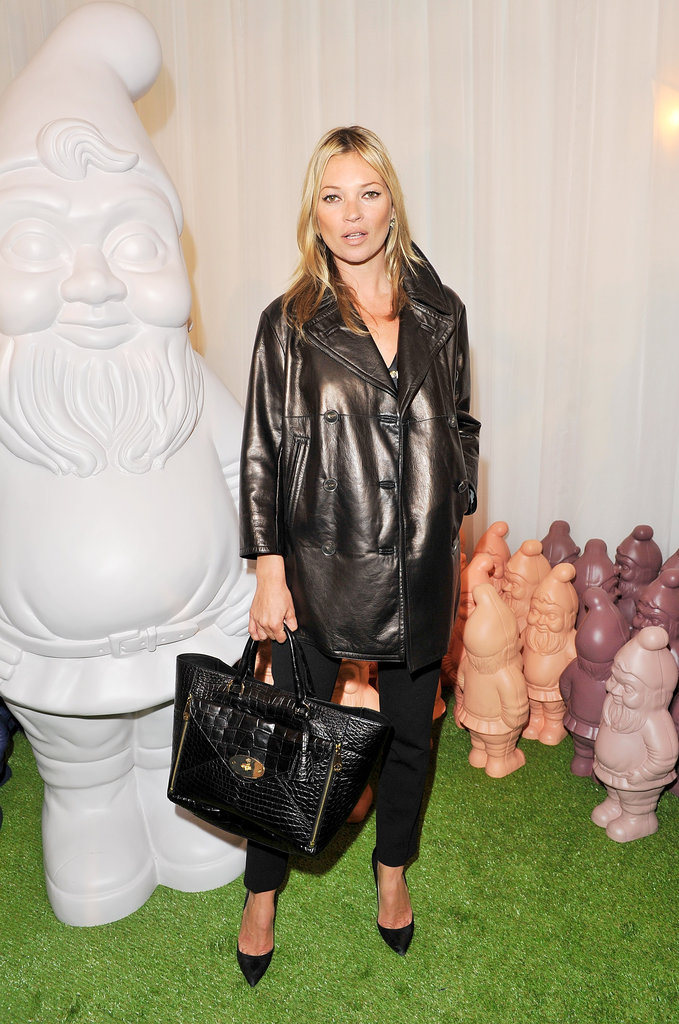 Kate Moss struck a pose at the Mulberry show in London.