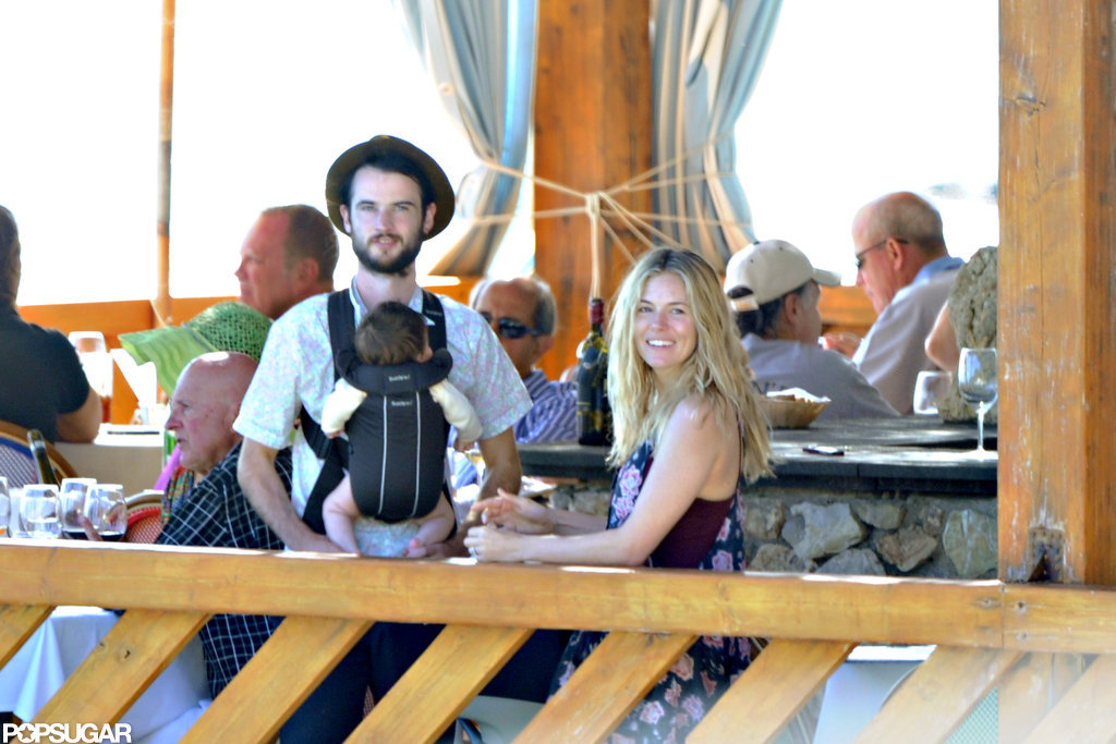 Tom Sturridge held baby Marlowe during a getaway with Sienna Miller to Positano.