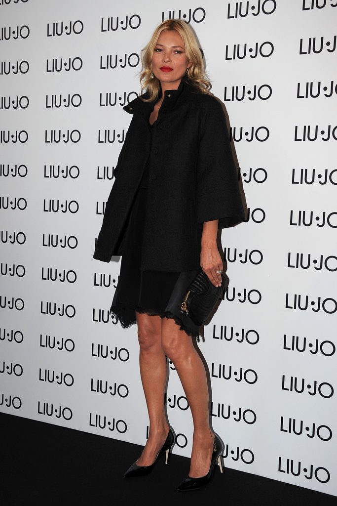 Kate Moss wore red lipstick at a Liu Jo party.