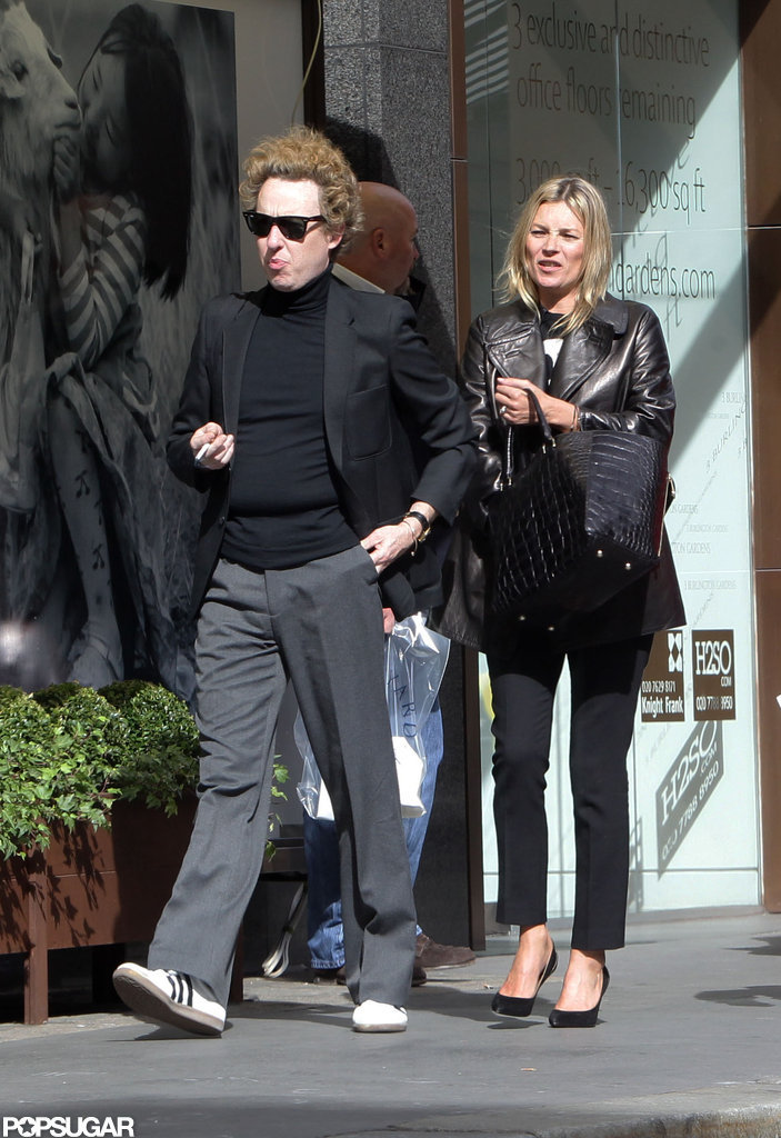 Kate Moss wore a black leather jacket.
