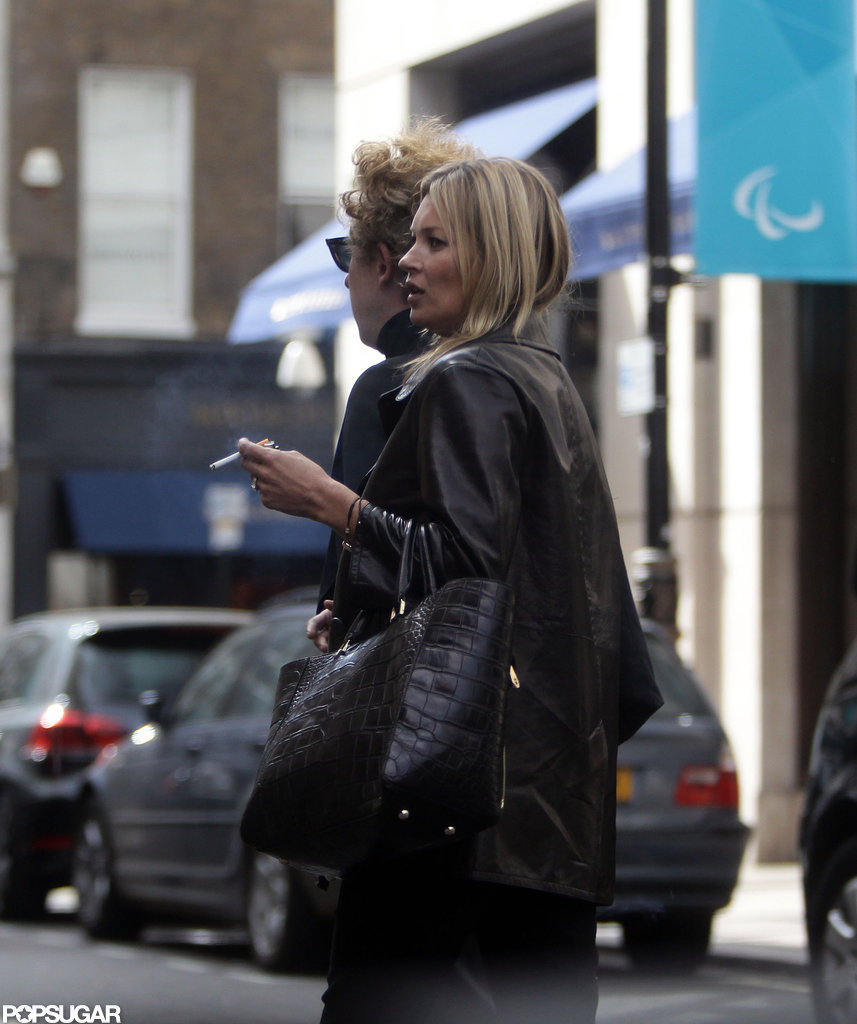 Kate Moss and James Brown crossed the street in London.