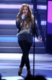 The singer performed on American Idol wearing a band tee topped with a black leather biker jacket. Sport your concert tees with this Just Eve black leather biker jacket ($549).