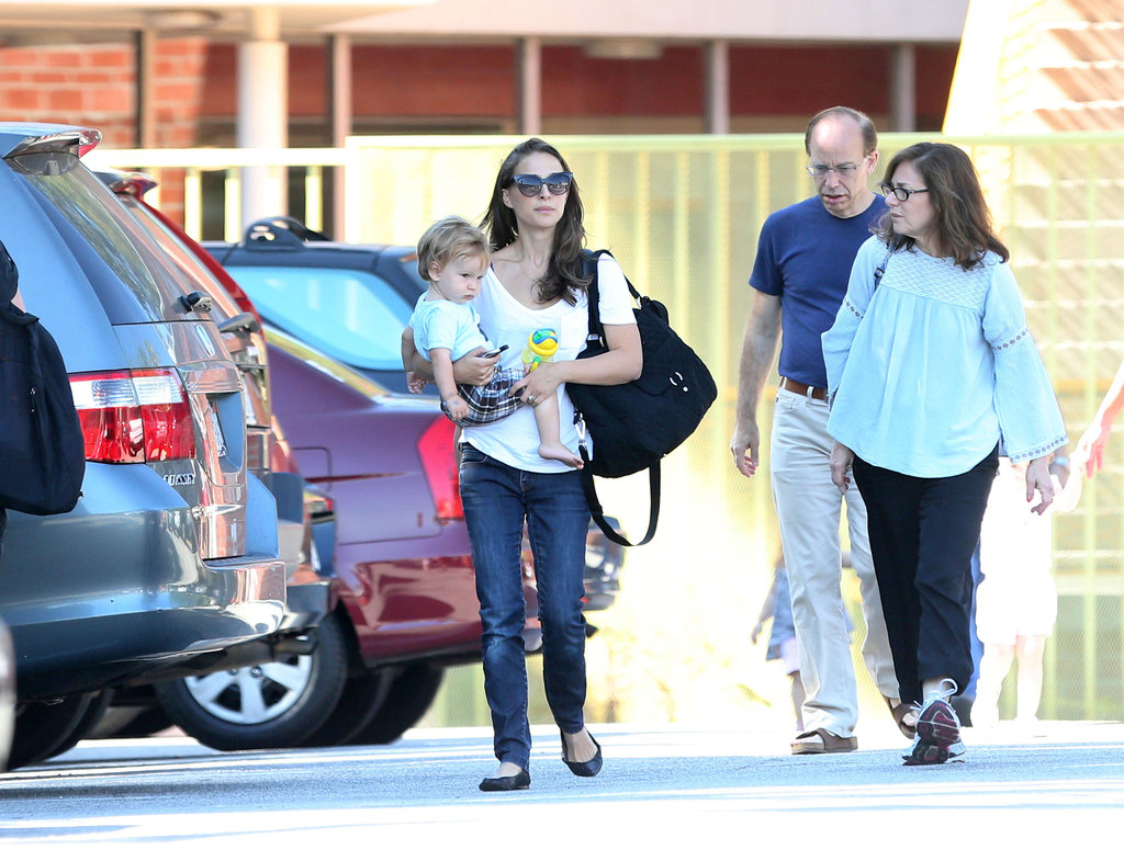 Natalie Portman and Aleph Millepied walked through a parking lot.