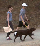 Anne Hathaway and Adam Shulman hiked with their dog.