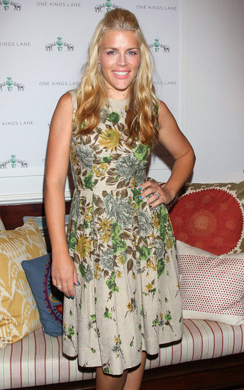 Busy Philipps posed in front of a couch she was donating.