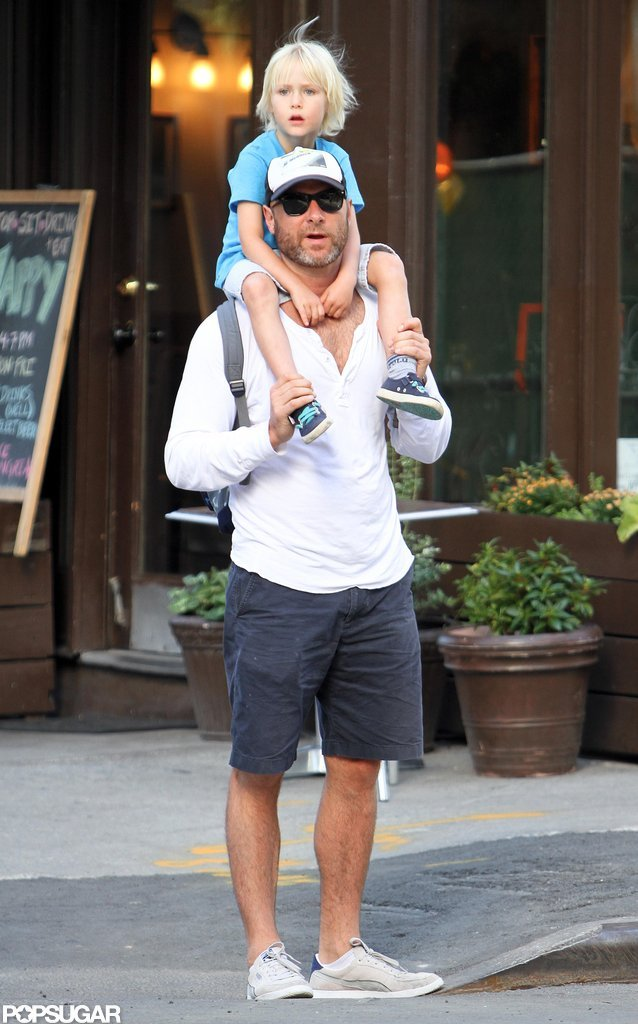 Sasha looked happy to be on his dad Liev Schreiber's shoulders in NYC.