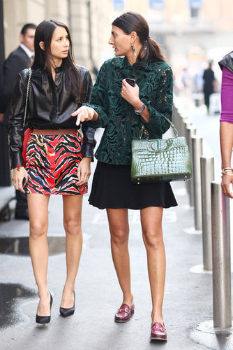 This duo took two different approaches to styling out their skirts — one in a fiery print, the other with a classic feel and loafers to match. Source: Greg Kessler
