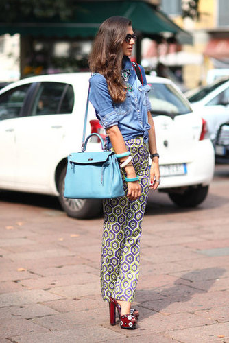 Head-to-toe cool, thanks to an effortless play on denim, bold print, and statement jewels and shoes. Source: Greg Kessler