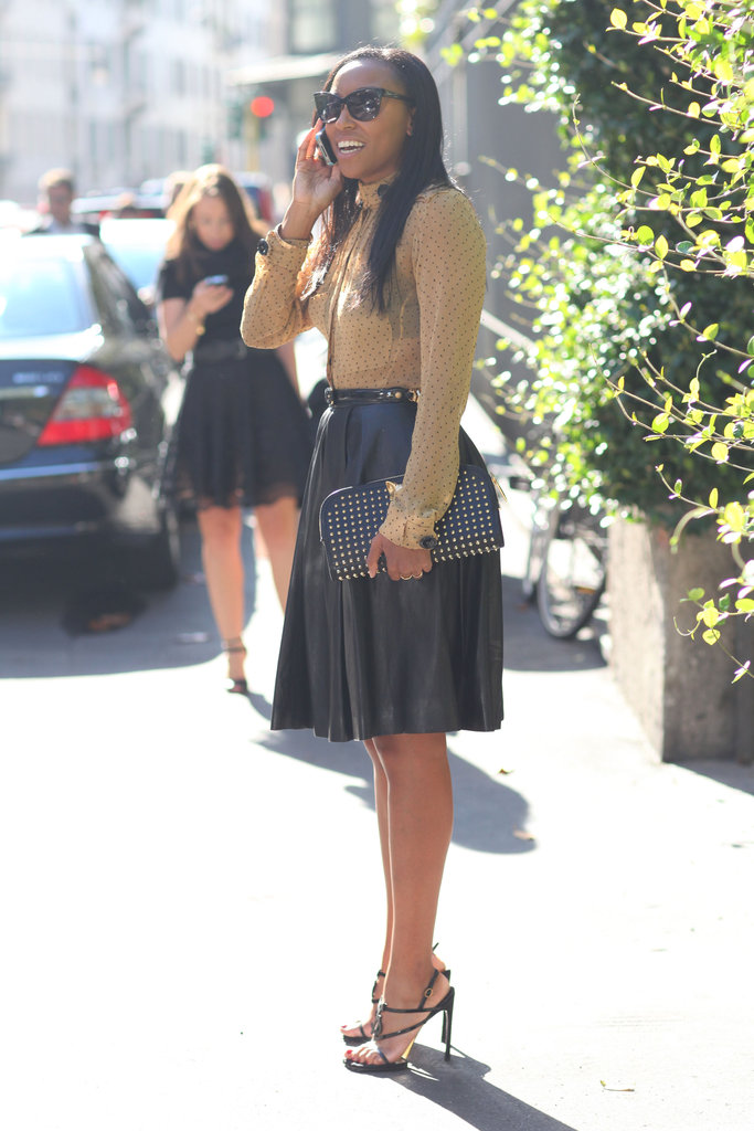 We love the way a sweet blouse gave a girlie twist to a full leather skirt. Source: Greg Kessler