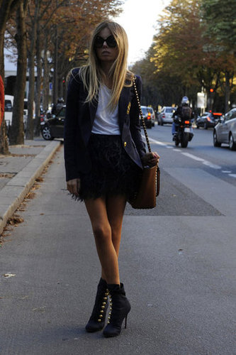 A feathered skirt was a glamorous counter to a preppy blazer.