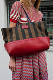 Totally striped and totally coordinated, this Fendi tote complemented her striped tee without being too matchy-matchy. Source: IMAXtree