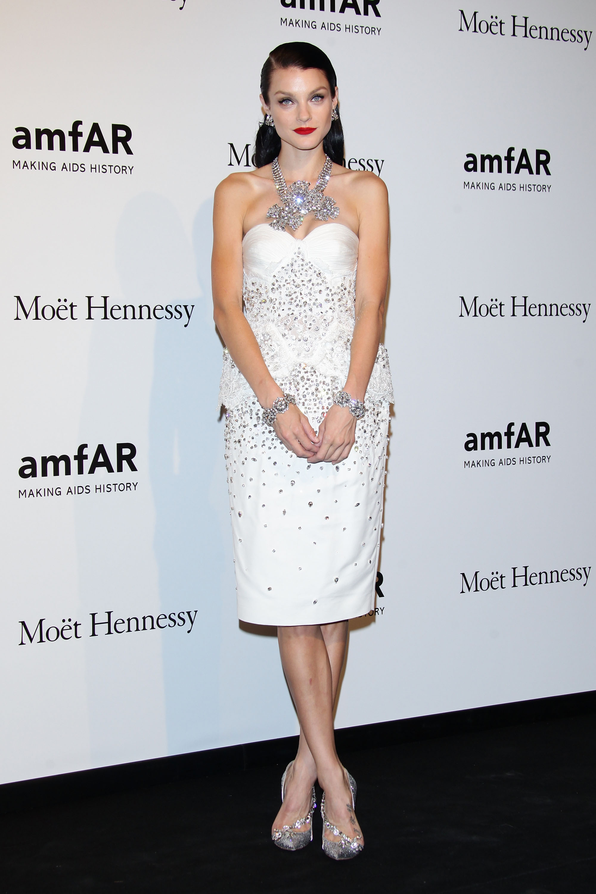 Jessica Stam opted for an ultraglam confection and a red lip for a night out at amfAR in Milan.