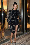 Blogger Denni Elias punched up an LBD with a cross-printed coat and gold ankle-strap pumps at the Just Cavalli opening.
