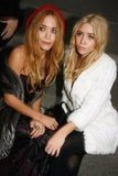 Mary-Kate Olsen and Ashley Olsen sat together at the Christian Dior show in October 2006.