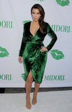 Kim Kardashian Coordinates a Green Gucci With Colorful Cocktails