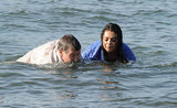 Mila Kunis and Robin Williams headed for the shore.