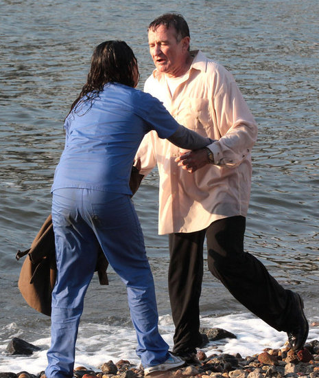 Mila Kunis and Robin Williams took a swim for a scene.