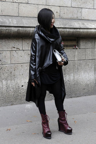 This styler took a fashion-forward angle with a leather parka and a bold pair of oxblood platforms.