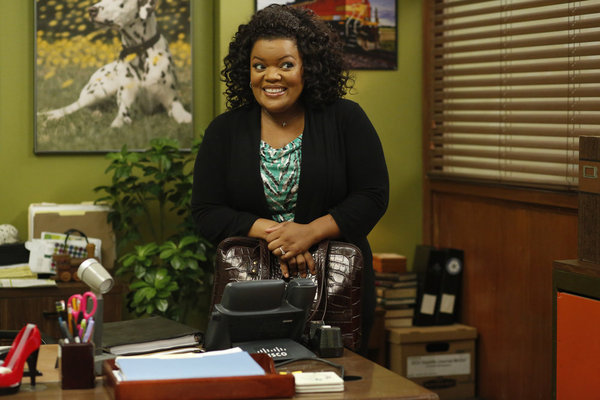 Shirley (Yvette Nicole Brown) smiles big, as usual.