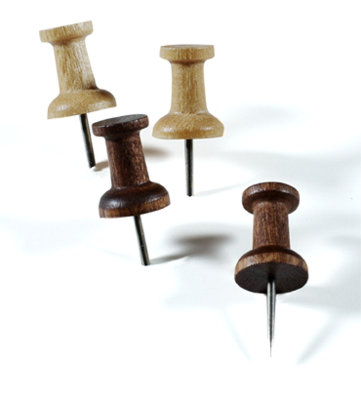 Notes and ideas will just stick with Container Store's Hardwood Pushpins ($3 for 20) in walnut or oak.
