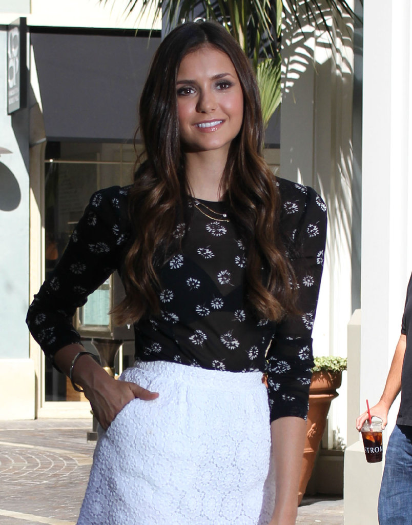 Nina Dobrev kept her long brown hair down.