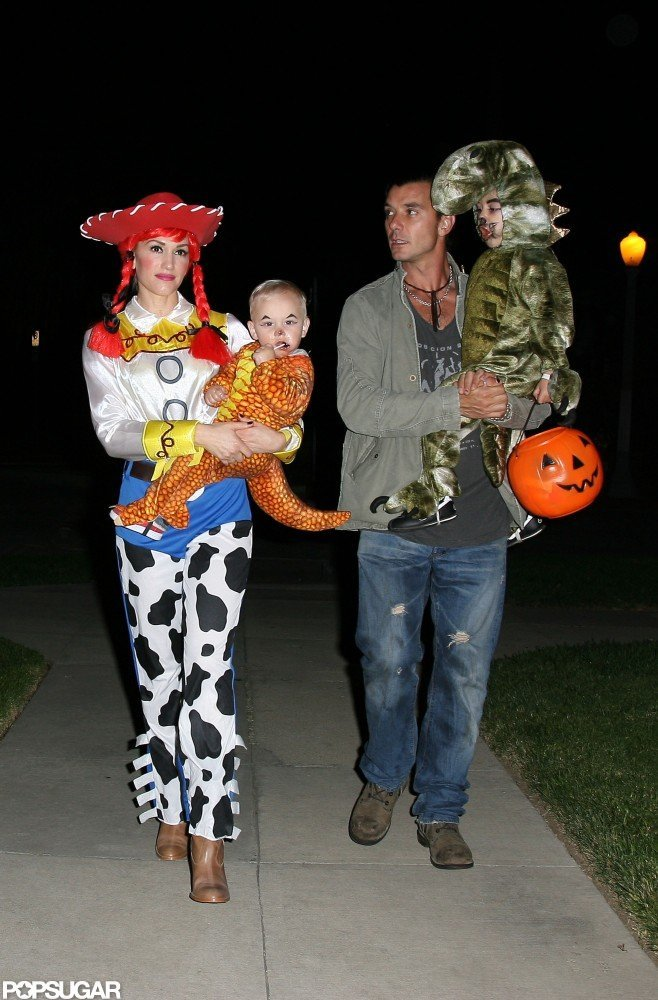 Gwen Stefani and Kingston Rossdale took their little dinosaurs Kingston and Zuma trick-or-treating near their LA home in 2009.